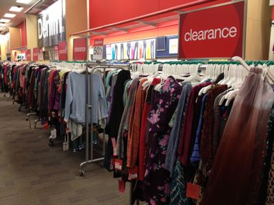 Word SALE from garments for clearance time in clothing stores