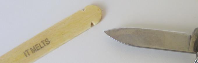 Cut notches in Popsicle stick